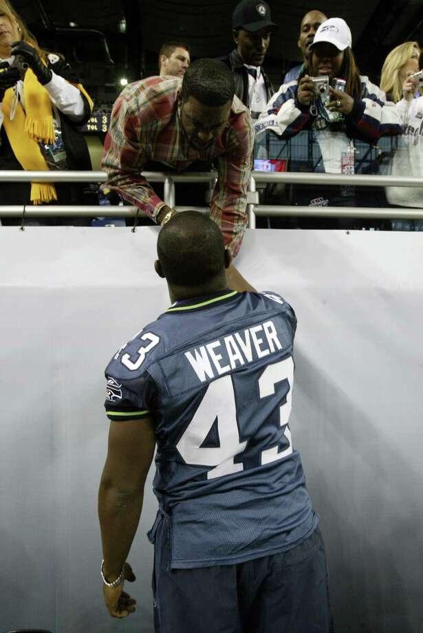 Leonard Weaver greets a fan. Photo: Mike Urban/seattlepi.com/MOHAI / Seattle Post-Intelligencer