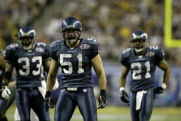 The Seattle defense (from left) of Marquand Manuel, Lofa Tatupu and Andre Dyson get fired up. Photo: Mike Urban/seattlepi.com/MOHAI / Seattle Post-Intelligencer