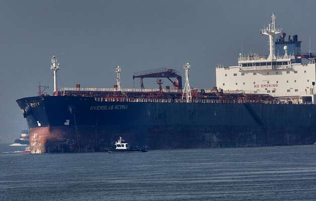 Officials checked the hull of the huge tanker as it sat in open water after the collision. An oil tanker struck the Bay Bridge Monday January 7, 2013.  Early assessment showed minor damage and the bridge remained open. Photo: Brant Ward, The Chronicle