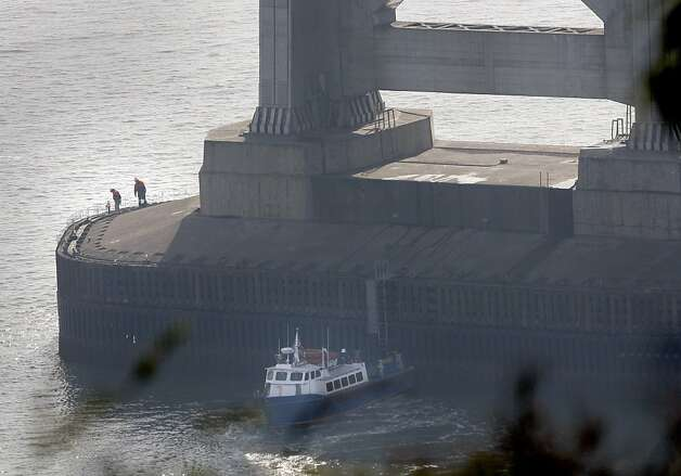 Officials checked the tower of the Bay Bridge closest to Treasure Island for damage from the collision. An oil tanker struck the Bay Bridge Monday January 7, 2013.  Early assessment showed minor damage and the bridge remained open. Photo: Brant Ward, The Chronicle