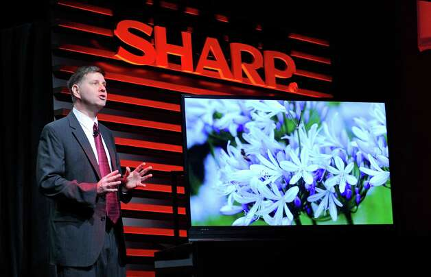 Sharp Electronics Vice President of Strategic Products Marketing Jim Sanduski unveils the Sharp ICC Purios 4K ultra HD television at a press event at the Mandalay Bay Convention Center for the 2013 International CES on January 7, 2013 in Las Vegas, Nevada. CES, the world's largest annual consumer technology trade show, runs from January 8-11 and is expected to feature 3,100 exhibitors showing off their latest products and services to about 150,000 attendees. Photo: David Becker, Getty Images / 2013 Getty Images