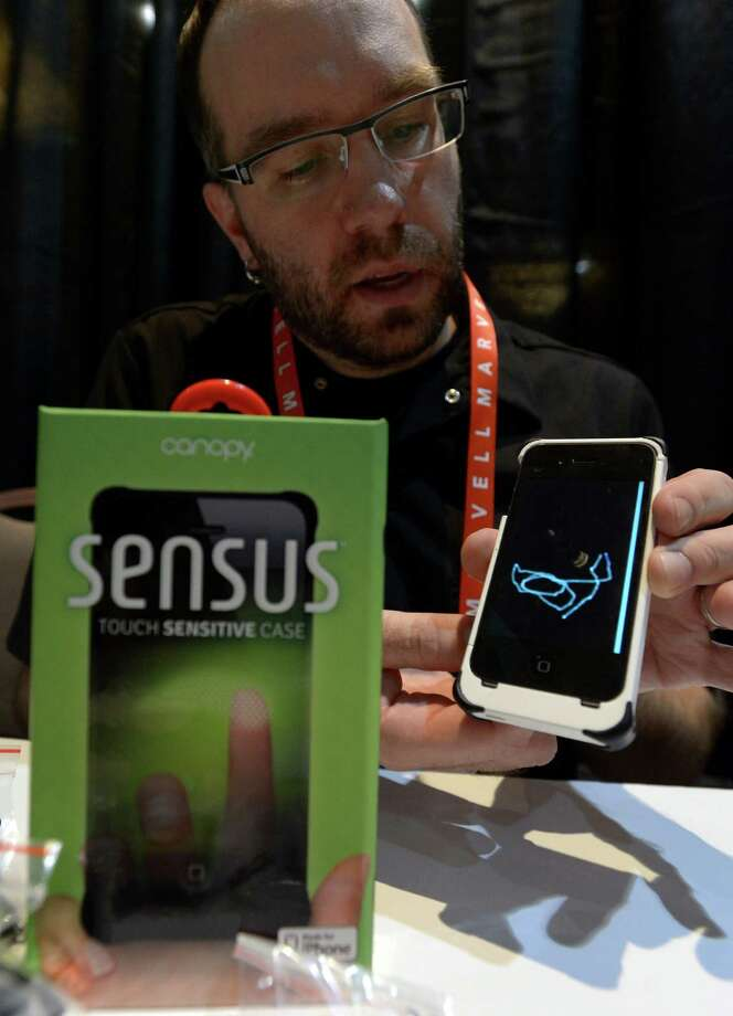 Matt Pacyga of Canopy shows Sensus touch sensitive case for iPhone during the opening event ''CES Unveiled''  during the  International Consumer Electronics Show (CES) in Mandalay Bay Hotel resort on January 06, 2013 in Las Vegas, Nevada.AFP PHOTO / JOE KLAMARJOE KLAMAR/AFP/Getty Images Photo: JOE KLAMAR, Getty Images / AFP