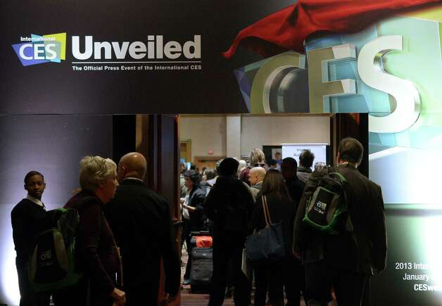 Journalists and visitors arrive to pre opening event ''CES Unveiled'' event during the International Consumer Electronics Show (CES) in Mandalay Bay Hotel resort on January 06, 2013 in Las Vegas, Nevada.     AFP PHOTO / JOE KLAMARJOE KLAMAR/AFP/Getty Images Photo: JOE KLAMAR, Getty Images / AFP