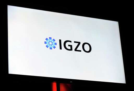 A video monitor displays the IGZO logo during a Sharp Electronics press event at the Mandalay Bay Convention Center for the 2013 International CES on January 7, 2013 in Las Vegas, Nevada. CES, the world's largest annual consumer technology trade show, runs from January 8-11 and is expected to feature 3,100 exhibitors showing off their latest products and services to about 150,000 attendees. Photo: David Becker, Getty Images / 2013 Getty Images