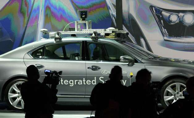Toyota presents an experimental automated car at the 2013 International Consumer Electronics Show in Las Vegas, Nevada, on January 7 ,2013. The annual CES which takes place from 8-11 January is a place where industry manufacturers, advertisers and tech-minded consumers converge to get a taste of new gadgets and innovations coming to the market each year.AFP PHOTO/JOE KLAMARJOE KLAMAR/AFP/Getty Images Photo: JOE KLAMAR, Getty Images / AFP