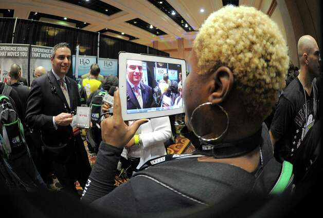 Journalists make interview with an iPad during the opening event ''CES Unveiled''  during the International Consumer Electronics Show (CES) in Mandalay Bay Hotel resort on January 06, 2013 in Las Vegas, Nevada.  AFP PHOTO / JOE KLAMARJOE KLAMAR/AFP/Getty Images Photo: JOE KLAMAR, Getty Images / AFP