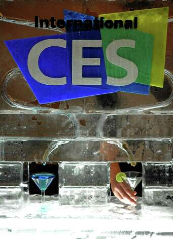 Waiters serve ice-cold Martini during the opening event ''CES Unveiled''  during the  International Consumer Electronics Show (CES) in Mandalay Bay Hotel resort on January 06, 2013 in Las Vegas, Nevada.AFP PHOTO / JOE KLAMARJOE KLAMAR/AFP/Getty Images Photo: JOE KLAMAR, Getty Images / AFP