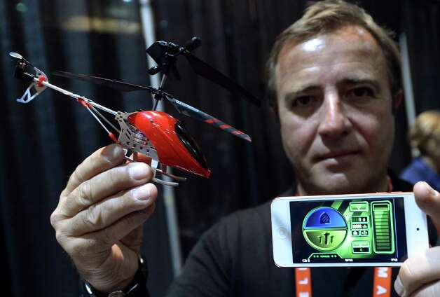Thierry Dechatre of Avenir Telecom shows BeWii bluetooth operated heliccopter by iPhone during the opening event ''CES Unveiled''  during the  International Consumer Electronics Show (CES) in Mandalay Bay Hotel resort on January 06, 2013 in Las Vegas, Nevada.AFP PHOTO / JOE KLAMARJOE KLAMAR/AFP/Getty Images Photo: JOE KLAMAR, Getty Images / AFP