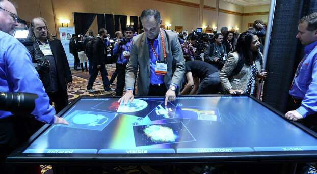 Diego Romeu of 3M Touch Systems shows 84 inch touch table during the opening event ''CES Unveiled''  during the  International Consumer Electronics Show (CES) in Mandalay Bay Hotel resort on January 06, 2013 in Las Vegas, Nevada.AFP PHOTO / JOE KLAMARJOE KLAMAR/AFP/Getty Images Photo: JOE KLAMAR, Getty Images / AFP