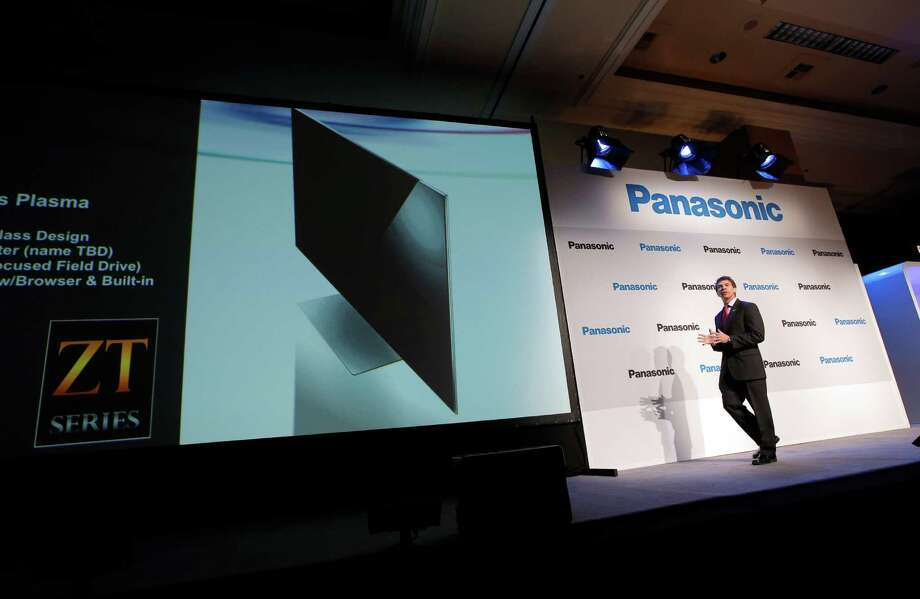 Panasonic's Vic Carlson, right, introduces the new television during a news conference at the International Consumer Electronics Show in Las Vegas, Monday, Jan. 7, 2013. The 2013 International CES gadget show, the biggest trade show in the Americas, is taking place in Las Vegas this week.  (AP Photo/Jae C. Hong) Photo: Jae C. Hong, Associated Press / AP