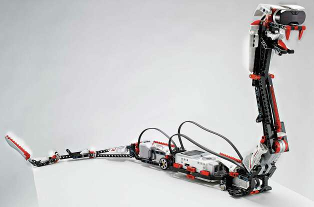 "This undated photo provided by Lego shows ""Reptar,"" a robotic snake that is one of 17 possible creations available in the new, $350 Lego Mindstorms EV3 platform that will have the ability to talk to iPhones, iPads and iPod Touches through Bluetooth wireless connections. Lego is scheduled to announce the kit at the International Consumer Electronics Show, Monday, Jan. 7, 2013, in Las Vegas. (AP Photo/LEGO) Photo: Philip Elberling, Associated Press / LEGO"