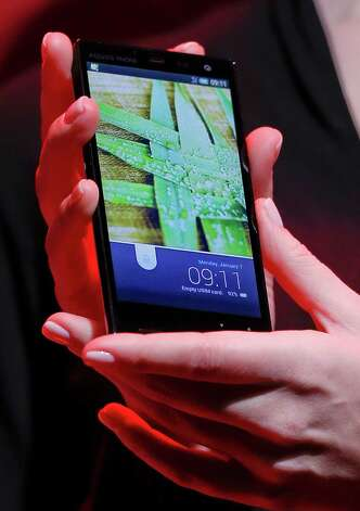 Sharp Electronics IGZO powered Aquos phone is modeled during a news conference during press day at the Consumer Electronics Show, Monday, Jan. 7, 2013, in Las Vegas. (AP Photo/Julie Jacobson) Photo: Julie Jacobson, Associated Press / AP
