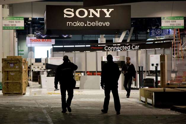 Las Vegas Convention Center exhibit contractors enter the North Hall while setting up spaces for the International Consumer Electronics Show, Sunday, Jan. 6, 2013, in Las Vegas. The show, which drew more than 3,100 consumer electronics exhibitors in 2012 and is open only to industry affiliates, begins Tuesday and runs through Friday. (AP Photo/Julie Jacobson) Photo: Julie Jacobson, Associated Press / AP