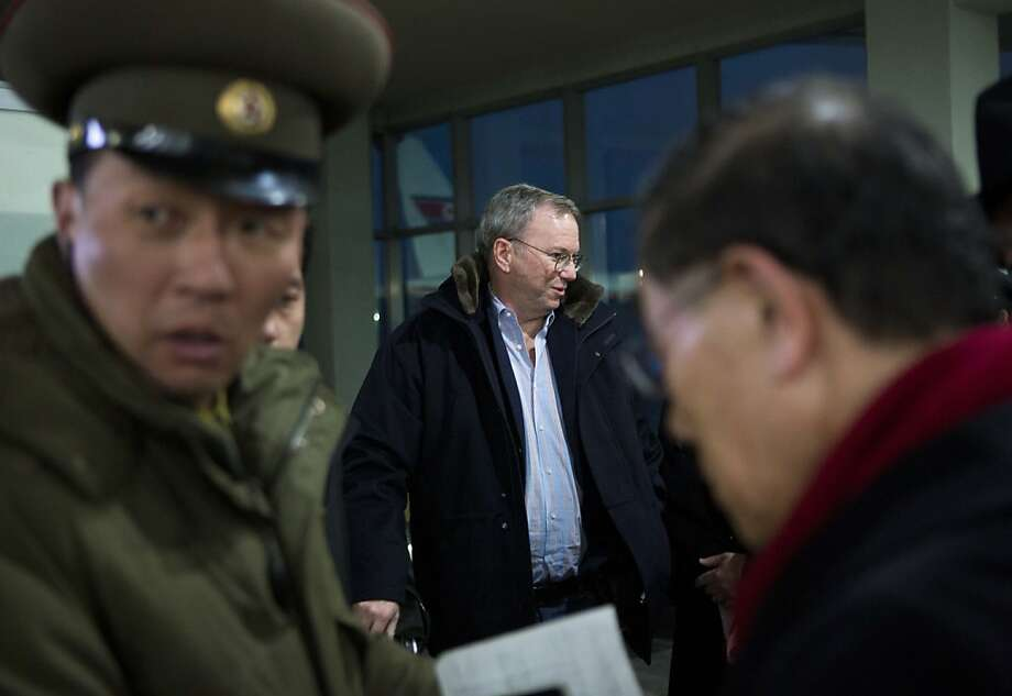 Eric Schmidt, Google's executive chairman (center), arrives at North Korea's Pyongyang International Airport on what delegation leader Bill Richardson calls a humanitarian mission. Photo: David Guttenfelder, Associated Press