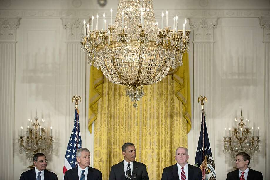 President Obama backs Chuck Hagel (second from left) as defense secretary and John Brennan (second from right) as CIA director, replacing Leon Panetta (left) in defense and Michael Morell (right) in the CIA. Photo: Brendan Smialowski, AFP/Getty Images