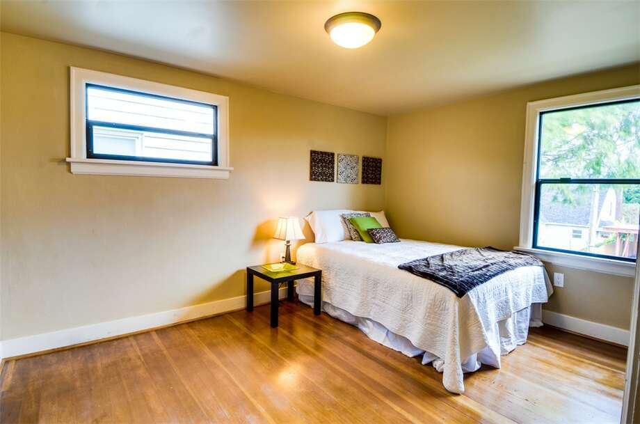 Bedroom of 5040 36th Ave. S.W. The 2,450-square-foot remodeled Tudor, built in 1928, has four bedrooms, 1.75 bathrooms, coved ceilings, a new kitchen and a rec room on a 4,800-square-foot lot. It's listed for $585,000. Photo: Miguel Edwards/Courtesy Michael Busacca/Skyline Properties