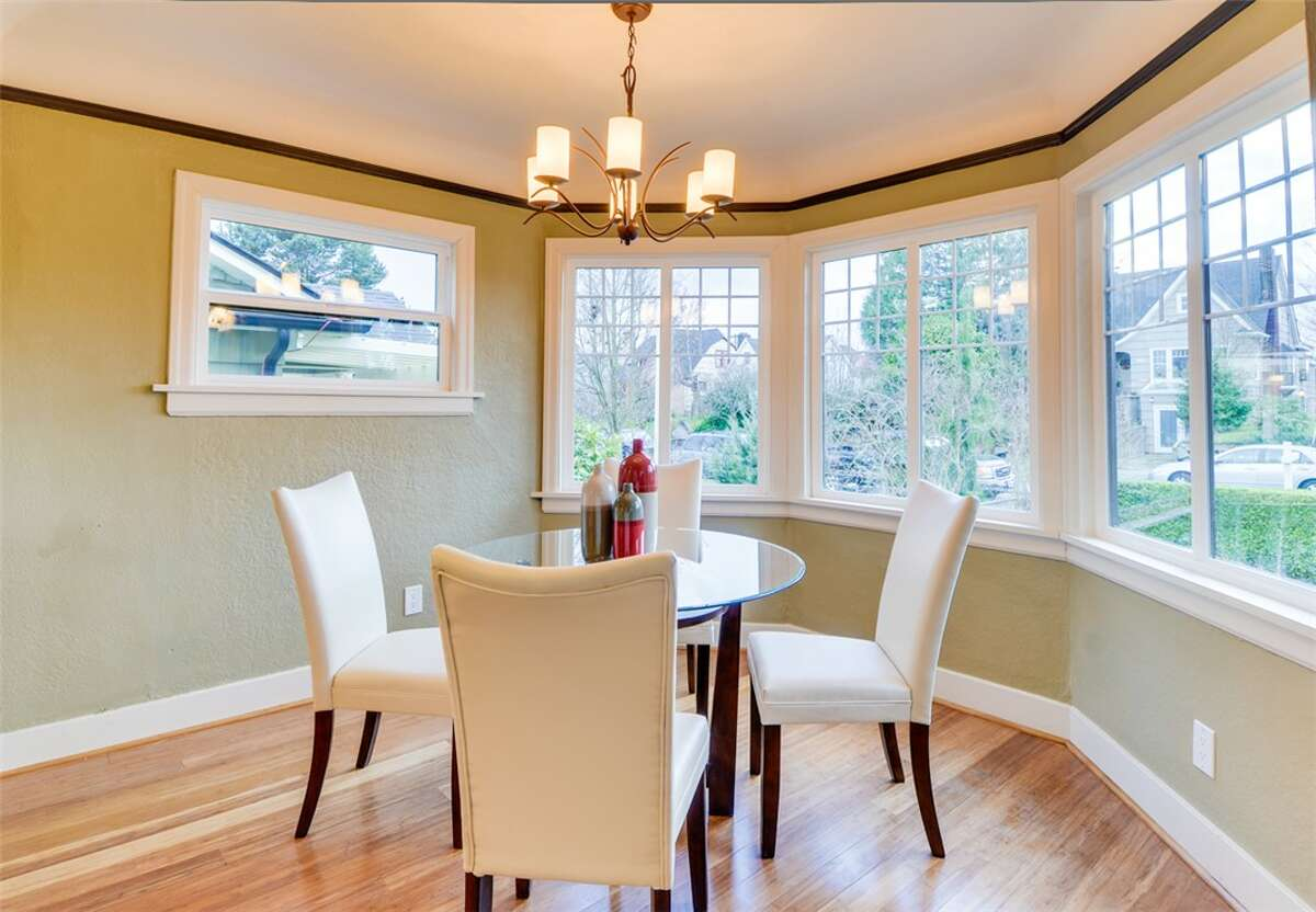 Dining room of 5040 36th Ave. S.W. The 2,450-square-foot remodeled Tudor, built in 1928, has four bedrooms, 1.75 bathrooms, coved ceilings, a new kitchen and a rec room on a 4,800-square-foot lot. It's listed for $585,000.