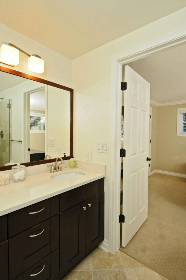 Bathroom of 5916 37th Ave. S.W. The 2,860-square-foot Cape Cod-style house, built in 1944, has four bedrooms, 1.75 bathrooms, an updated kitchen, a family room, a rec room and a patio on a 6,400-square-foot lot. It's listed for $539,000, although a sale is pending. Photo: Courtesy Leslie Fox/Windermere Real Estate