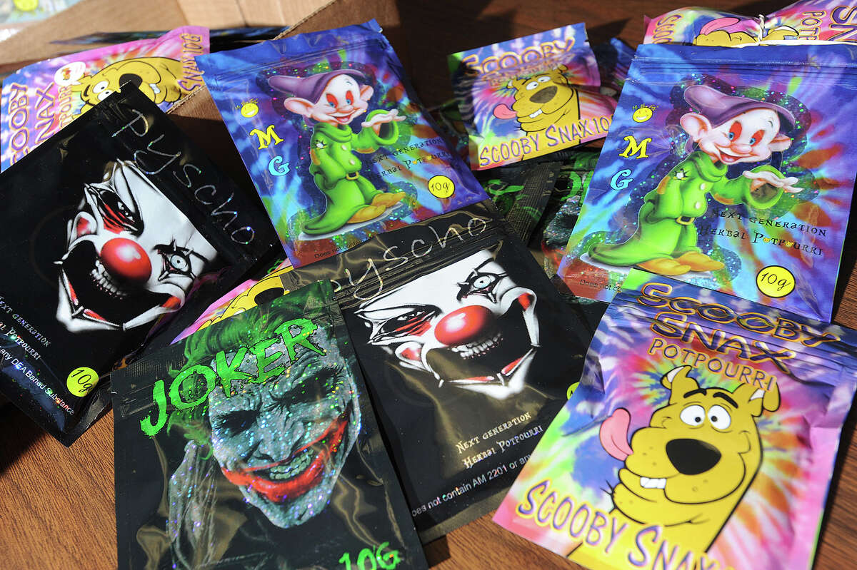 Using cartoon characters such as Scooby Doo, Dopey, and the Joker, Jefferson County Sheriff's deputy Ron Hobbs said that synthetic marijuana producers are marketing toward children. Numerous packages, labeled as potpourri, were confiscated by deputies at a convenience store on Avenue A and Washington Boulevard on Friday. Photo taken Monday, January, 07, 2013 Guiseppe Barranco/The Enterprise