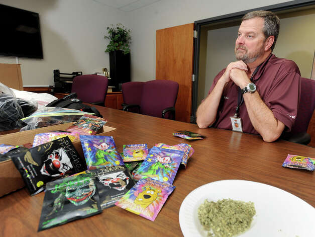 Jefferson County Sheriff's deputy Ron Hobbs said that synthetic marijuana producers are marketing their products toward children. Numerous packages, labeled as potpourri, were confiscated by deputies at a convenience store on Avenue A and Washington Boulevard on Friday.   Photo taken Monday, January, 07, 2013 Guiseppe Barranco/The Enterprise Photo: Guiseppe Barranco, STAFF PHOTOGRAPHER / The Beaumont Enterprise