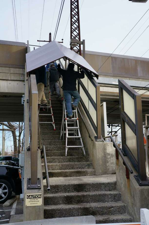 Canopies are being installed over the stairs at the downtown train station in Fairfield, Conn.. Photo: Genevieve Reilly / Fairfield Citizen