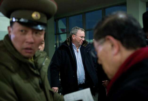 Executive Chairman of Google Eric Schmidt, center, arrives at Pyongyang International Airport in Pyongyang, North Korea on Monday, Jan. 7, 2013. Schmidt arrived in the North Korean capital along with former New Mexico Gov. Bill Richardson. Richardson called the trip to North Korea a private humanitarian visit. (AP Photo/David Guttenfelder) Photo: David Guttenfelder