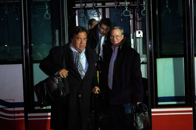 Former New Mexico Gov. Bill Richardson, left, and Executive Chairman of Google, Eric Schmidt, disembark from an airport transfer bus after arriving at Pyongyang International Airport in Pyongyang, North Korea on Monday, Jan. 7, 2013. Richardson called the trip to North Korea a private humanitarian visit. In the background is Google Ideas think tank director, Jared Cohen. (AP Photo/David Guttenfelder) Photo: David Guttenfelder