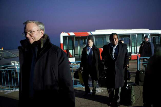 Executive Chairman of Google Eric Schmidt, left, disembarks from an airport transfer bus after arriving at Pyongyang International Airport in Pyongyang, North Korea on Monday, Jan. 7, 2013. Behind him, from left to right, are Google Ideas think tank director Jared Cohen and former New Mexico Gov. Bill Richardson. Richardson called the trip to North Korea a private humanitarian visit. (AP Photo/David Guttenfelder) Photo: David Guttenfelder