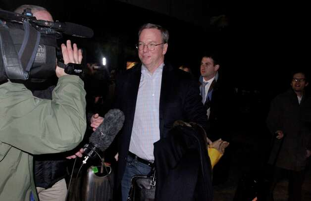 Executive Chairman of Google Eric Schmidt is surrounded by journalists after arriving at Pyongyang International Airport in Pyongyang, North Korea on Monday, Jan. 7, 2013. Schmidt arrived in the North Korean capital, along with former New Mexico Gov. Bill Richardson. Richardson called the trip to North Korea a private humanitarian visit. (AP Photo/Kim Kwang Hyon) Photo: Kim Kwang Hyon