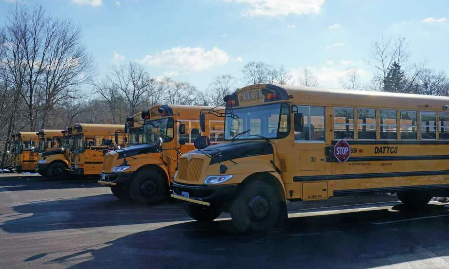 A view of DATTCO buses parked in the Imperial Avenue lot. DATTCO received nine tickets from the Department of Motor Vehicles for violations recorded by DMV inspectors during a Nov. 28 visit to DATTCO's Post Road East bus yard. Photo: Paul Schott / Westport News