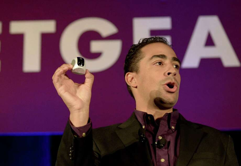 Netgear Vice President of Engineering David Henry holds up a VueZone wireless camera. Photo: JOE KLAMAR, AFP/Getty Images / AFP