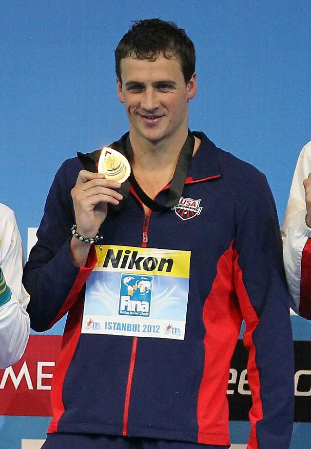 Gold medalist Ryan Lochte of U.S. poses for the photographers during men's 100 meters individual medley victory ceremony during the FINA Short Course Swimming World Championships at the Sinan Erdem Arena in Istanbul, Sunday, Dec. 16, 2012. (AP Photo/Thanassis Stavrakis) Photo: Thanassis Stavrakis, Associated Press