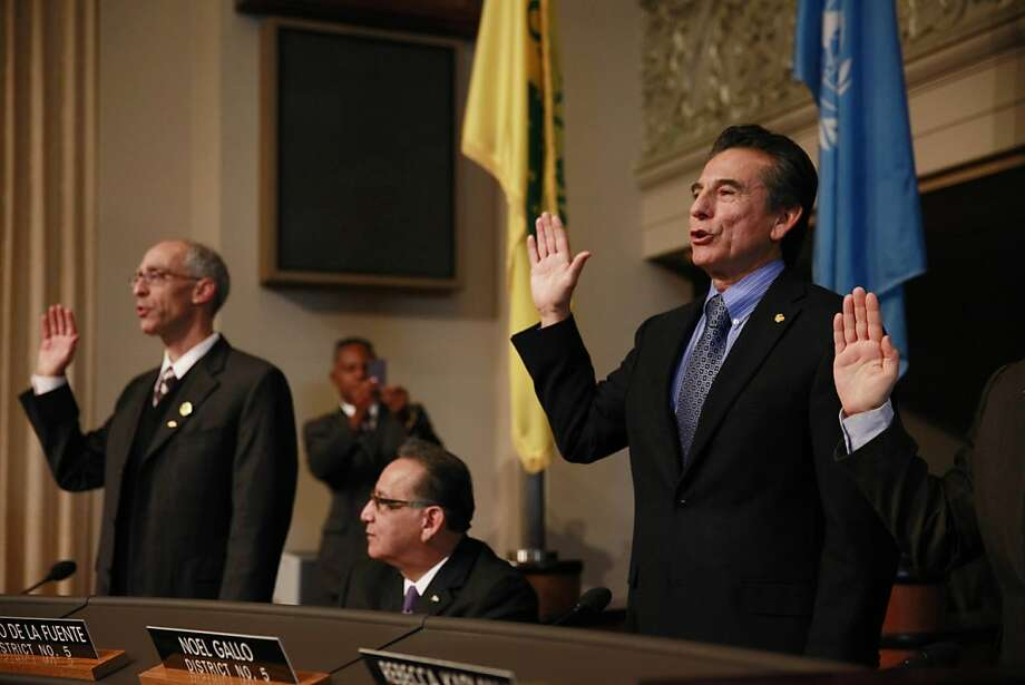 City Council members Dan Kalb (left) and Noel Gallo (right) are sworn in at the City of Oakland Inauguration Ceremony in City Hall on Monday, January 7, 2013 in Oakland, Calif. Photo: Lea Suzuki, The Chronicle
