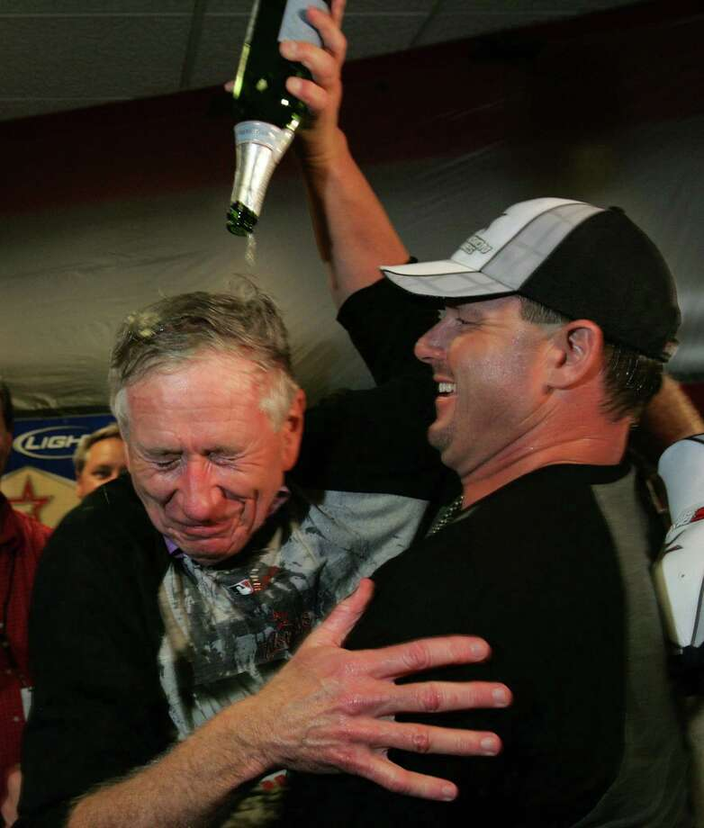 Astros pitcher Roger Clemens, right, pours champagne on team owner Drayton McLane as they celebrate the Astros' 6-4 victory over the Chicago Cubs to earn a wildcard playoff berth Oct. 2, 2005 at Minute Maid Park. Photo: BRETT COOMER, HOUSTON CHRONICLE / HOUSTON CHRONICLE