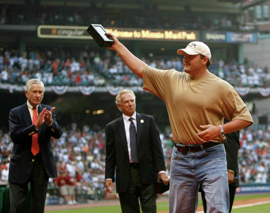 Roger Clemens waves to the crowd while holding his National League championship ring box with Astros owner Drayton McLane in the background during the ring ceremony. Photo: KAREN WARREN, Houston Chronicle / Houston Chronicle