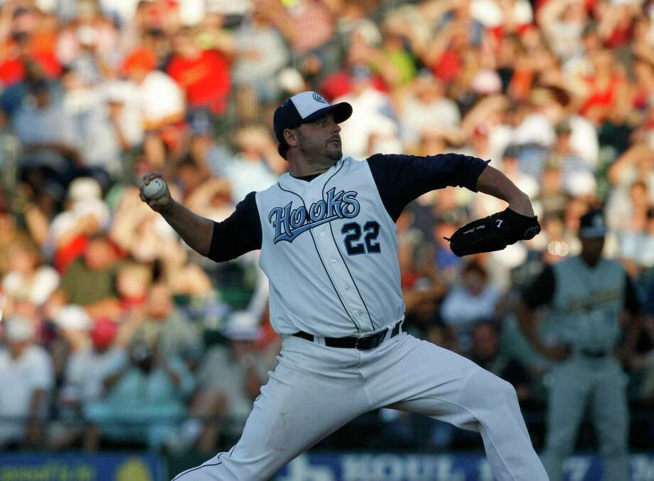 Roger Clemens pitches in the first inning during a Corpus Christi Hooks-San Antonio Missions minor league baseball game at Whataburger Field in Corpus Christi on June 11, 2006. Clemens started the game in preparation for his return to the Astros. Photo: KAREN WARREN, Houston Chronicle / Houston Chronicle