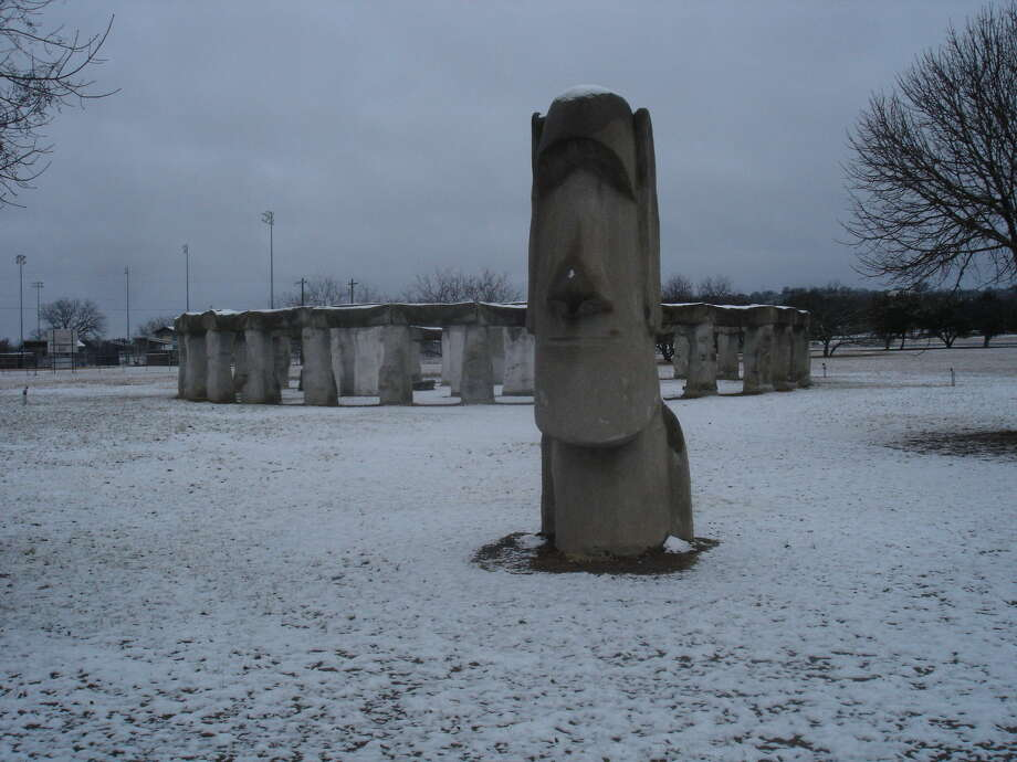 Snow sits on one of the Easter Island head replicas and Stonehenge II on the campus of the Hill Country Arts Foundation, at 120 Point Theatre Road in Ingram, about 65 miles northwest of San Antonio. Stonehenge II is free and open to the public daily. The photo was taken Jan. 4 when the Hill Country got a dusting of snow. Photo: San Antonio Express-News