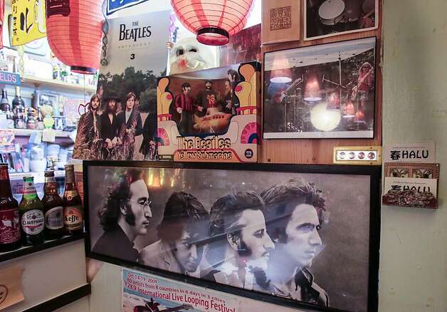 Beatles memorabilia lines the walls at Halu in San Francisco. Photo: John Storey, Special To The Chronicle