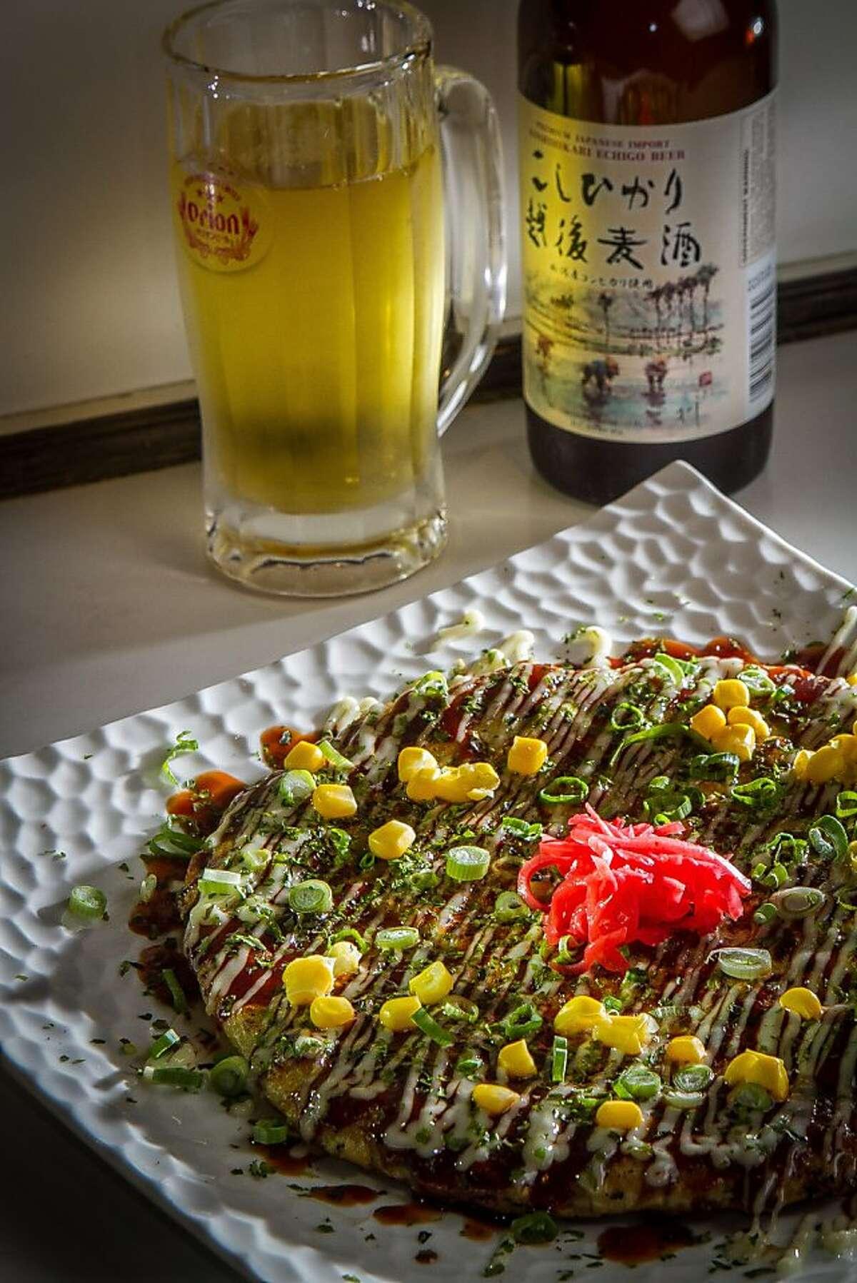 The Okonomiyaki pancake with a beer at Halu restaurant in San Francisco, Calif., is seen on Saturday, January 5th, 2013.