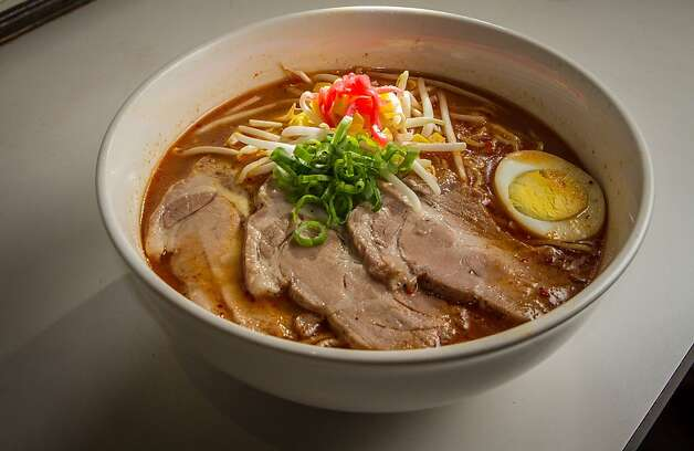 Above, the spicy lava ramen is a popular choice at Halu in the Richmond District. The tiny restaurant also offers an assortment of Japanese beers, like the one served with an okonomiyaki pancake at right. Halu is also known for its extensive collection of Beatles memorabilia, far right. Photo: John Storey, Special To The Chronicle