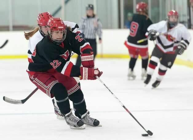New Canaan high school's Olivia Hompe moves the puck over the blue line in a girls ice hockey game against Greenwich high school played at the Dorothy Hamill Skating Rink, Greenwich, CT on Monday January 7th, 2013. Photo: Mark Conrad / Stamford Advocate Freelance