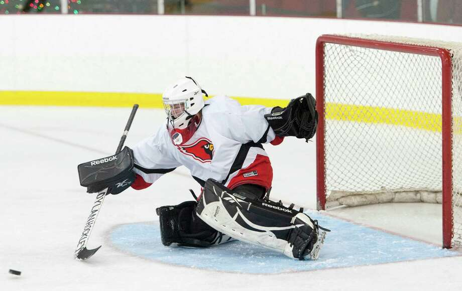 Greenwich high school goalie Dart Freccia makes a save in a girls ice hockey game against New Canaan high school played at the Dorothy Hamill Skating Rink, Greenwich, CT on Monday January 7th, 2013. Photo: Mark Conrad / Stamford Advocate Freelance