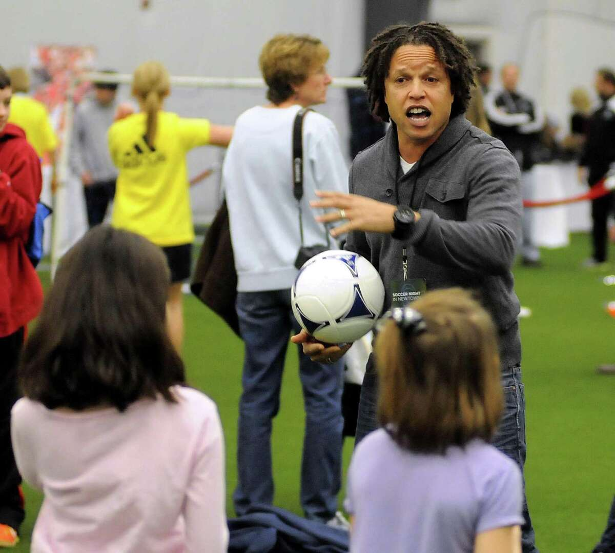 American soccer player, Cobi Jones, gives instructions to students during the Soccer Night in Newtown on Monday Jan. 7, 2013.