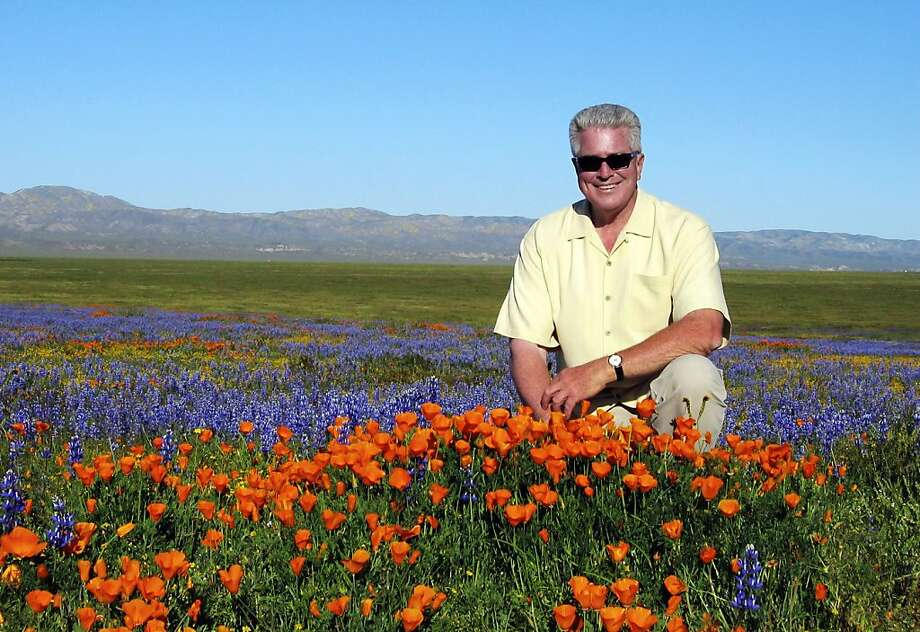"""CORRECTS SPELLING OF NAME TO HUELL NOT HULL FILE- In this March 31, 2005, file photo provided by the Howser production company via KCET, television host Huell Howser poses for a photo at the Antelope Valley California Poppy Reserve in Lancster, Calif. Howser, the homespun host of public television's popular """"California's Gold"""" travelogues, has died at age 67. Howser died at his home Sunday, Jan. 6, 2013, from natural causes, said Ayn Allen, corporate communications manager for KCET. (AP Photo/KCET, Howser Production Company) Photo: Uncredited, Associated Press"""