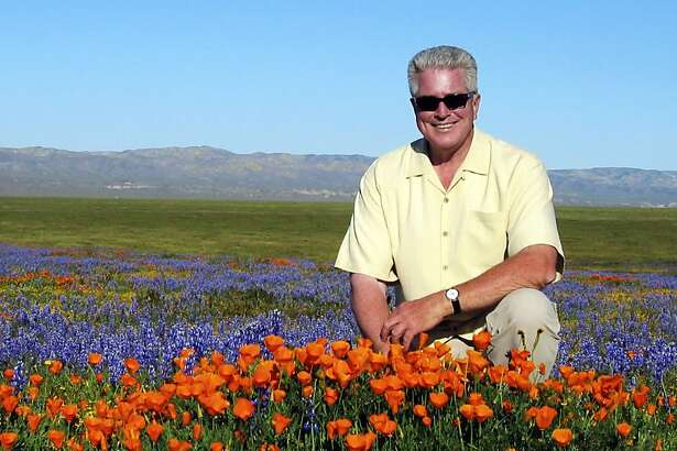 """CORRECTS SPELLING OF NAME TO HUELL NOT HULL FILE- In this March 31, 2005, file photo provided by the Howser production company via KCET, television host Huell Howser poses for a photo at the Antelope Valley California Poppy Reserve in Lancster, Calif. Howser, the homespun host of public television's popular """"California's Gold"""" travelogues, has died at age 67. Howser died at his home Sunday, Jan. 6, 2013, from natural causes, said Ayn Allen, corporate communications manager for KCET. (AP Photo/KCET, Howser Production Company)"""