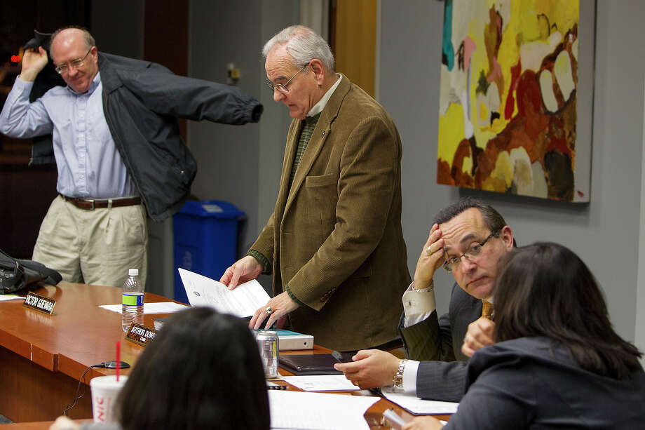 Ethics Review Board vice-chair Michael Ariens (from left), chair Arthur Downey, attorney Francisco J. Garza and Rosalinda Diaz clear out after cancelling a hearing due to lack of quorum. MICHAEL MILLER / FOR THE EXPRESS-NEWS