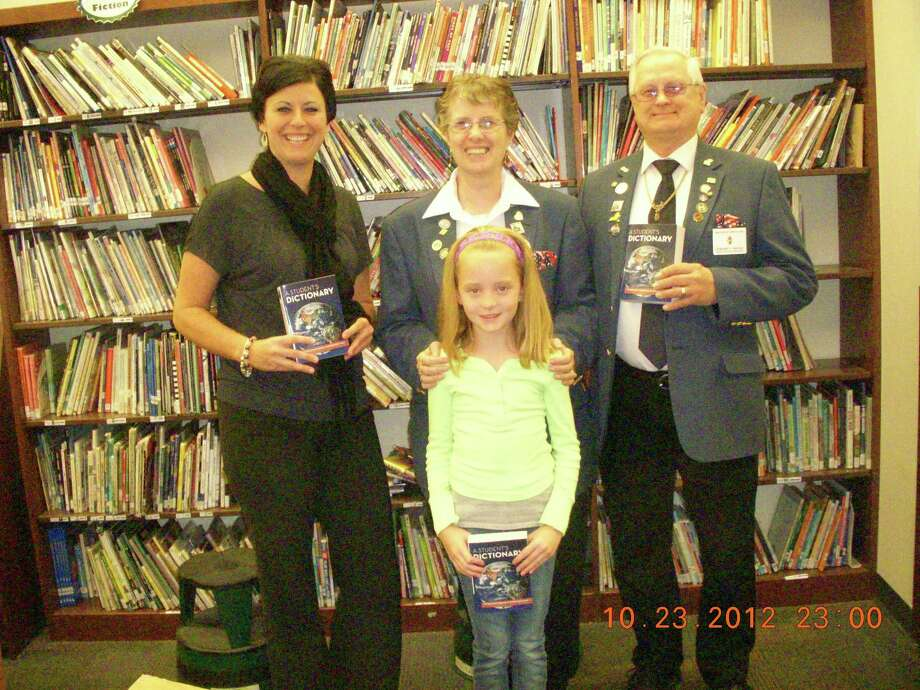 From left, Heatly Elementary School teacher Nicole Cioffi and Watervliet Elks Lodge representatives Johanna Baniak and Edward Baniak meet with third-grader Alexis Marie Cornwell. The Baniaks visited Menands, Heatly (Green Island) and Watervliet elementary schools to hand out dictionaries to a total of 161 third graders. (Nancy Caswell)