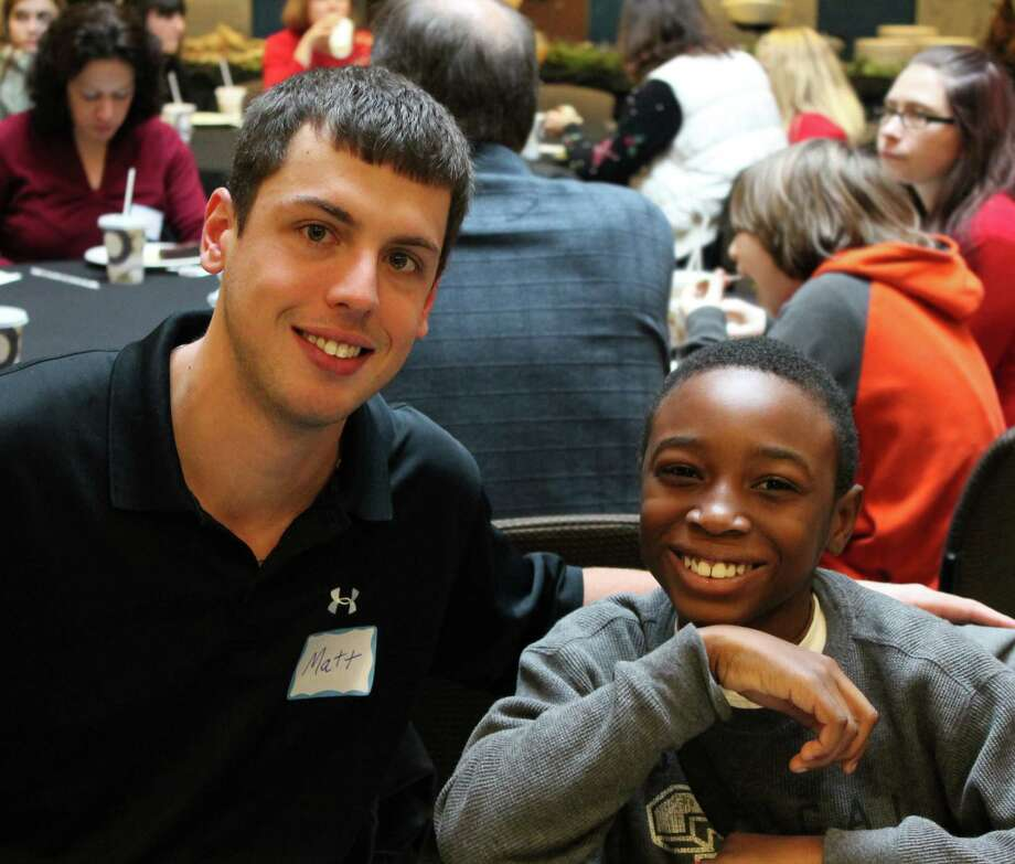 Big brother Matt (left) and little brother Nevaeh spend time together during an event for Big Brothers Big Sisters of the Capital Region. (Jessica S. Mansmith)