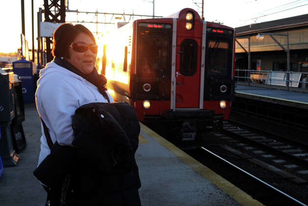 Vanessa Estrada, of New Haven, waits on the platform at the Fairfield railroad station as the eastbound Metro North train arrives Jan. 7th, 2012. Estrada, who works with special needs kids, rides Metro North to various locations several times a week. Photo: Ned Gerard / Connecticut Post