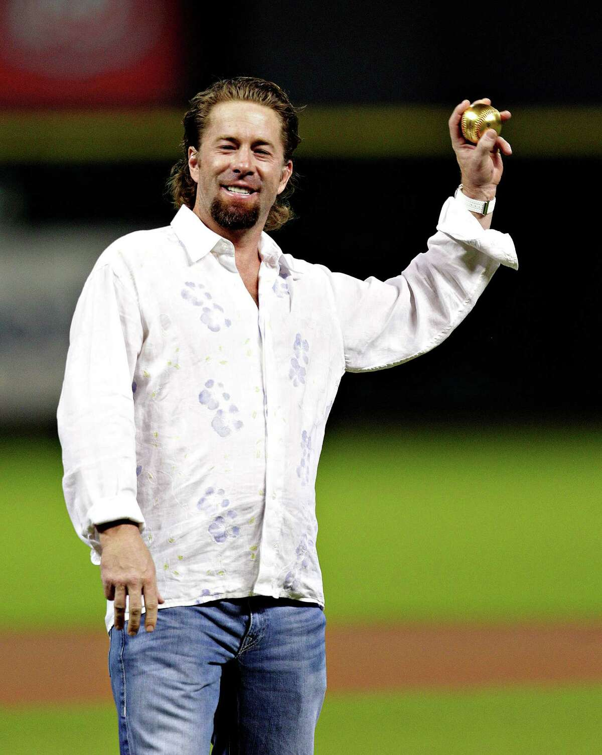 Jeff Bagwell throws out the first pitch lefthanded on Aug. 10, 2012, a concession to the right shoulder injury that ended his career.